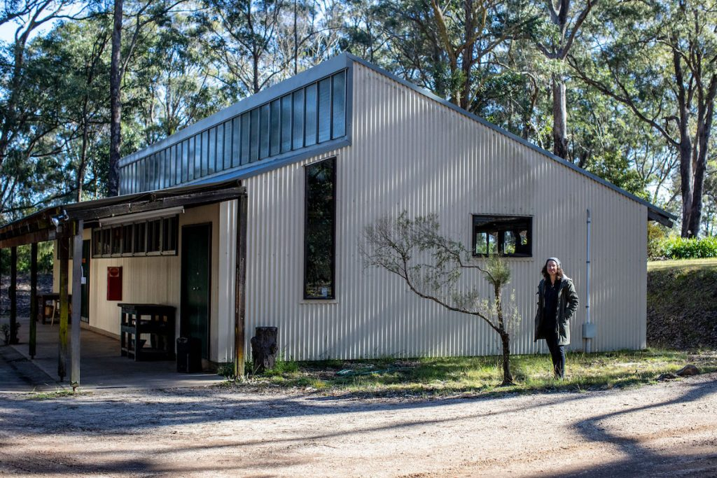 Lou standing outside of her Mittagong shed